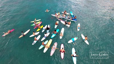 Paddle out for Pili and Matt's wedding in the ocean